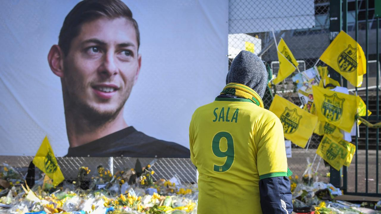 Supporters pay tribute in front of the portrait of Argentine forward Emiliano Sala at the Beaujoire stadium in Nantes. Picture: Loic Venance/AFP