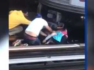 Chilling footage of girl rescued under train
