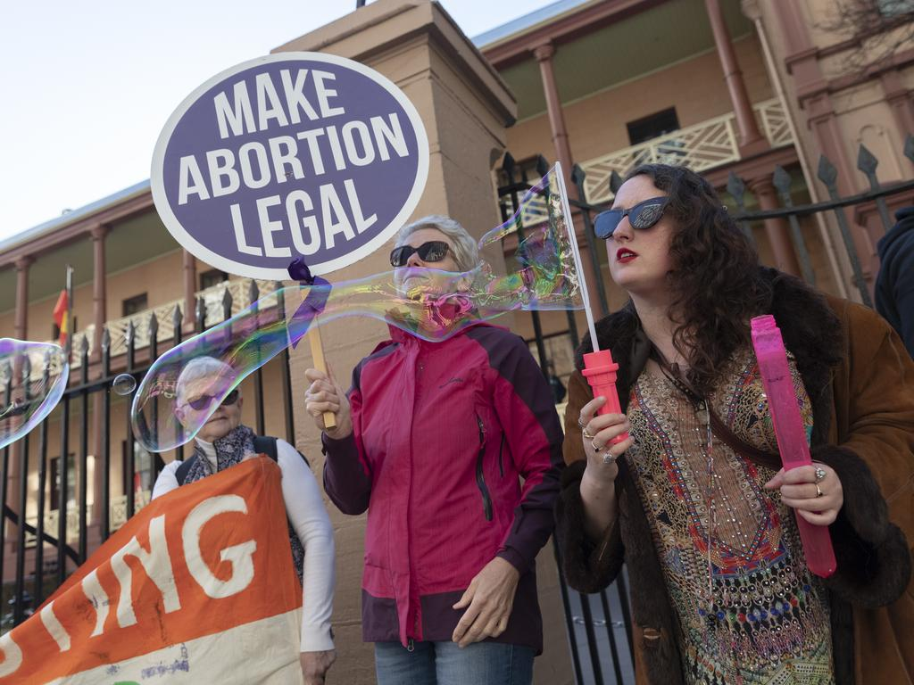 Sydneysiders attend an early morning rally at Parliament House in support of decriminalising abortion. Picture: Getty