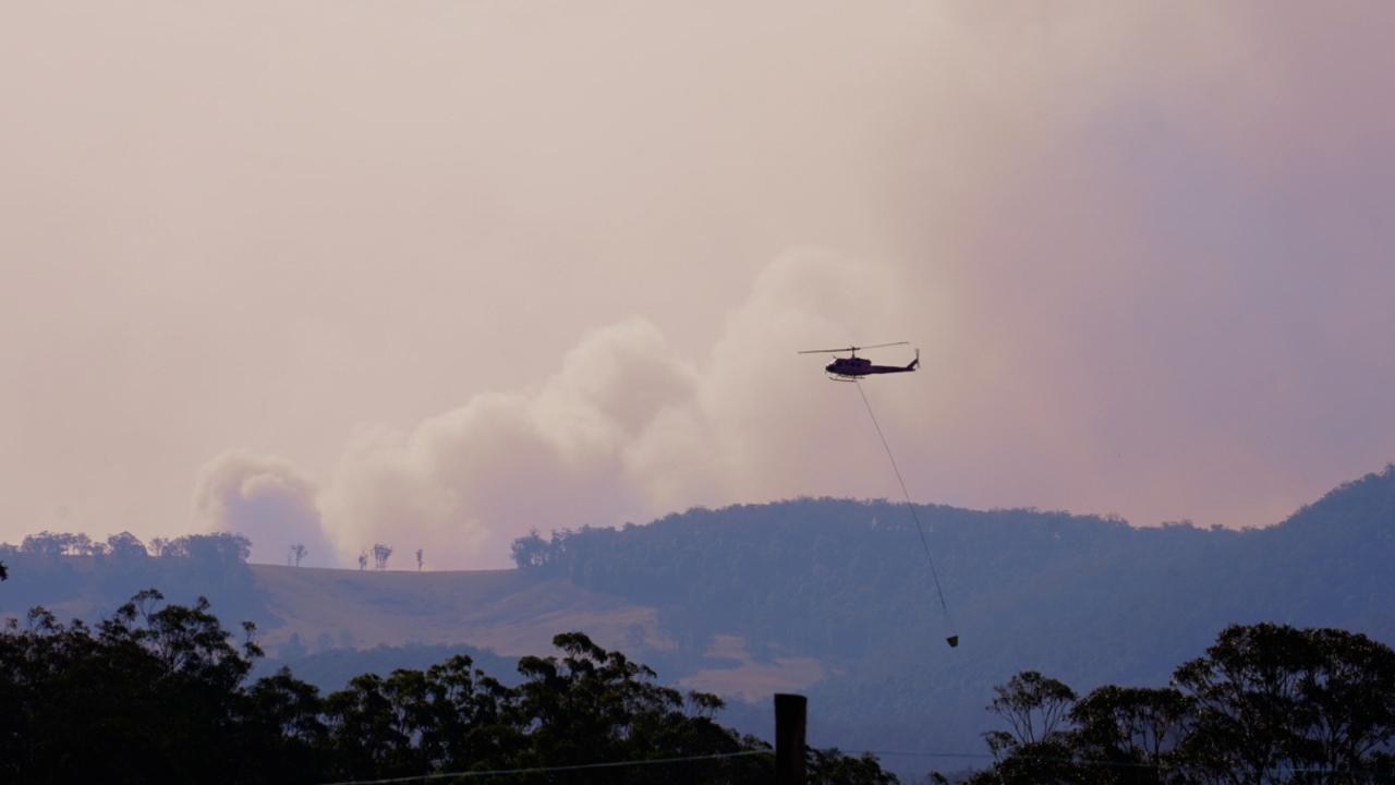 A chopper working to contain the fires west of Dorrigo.