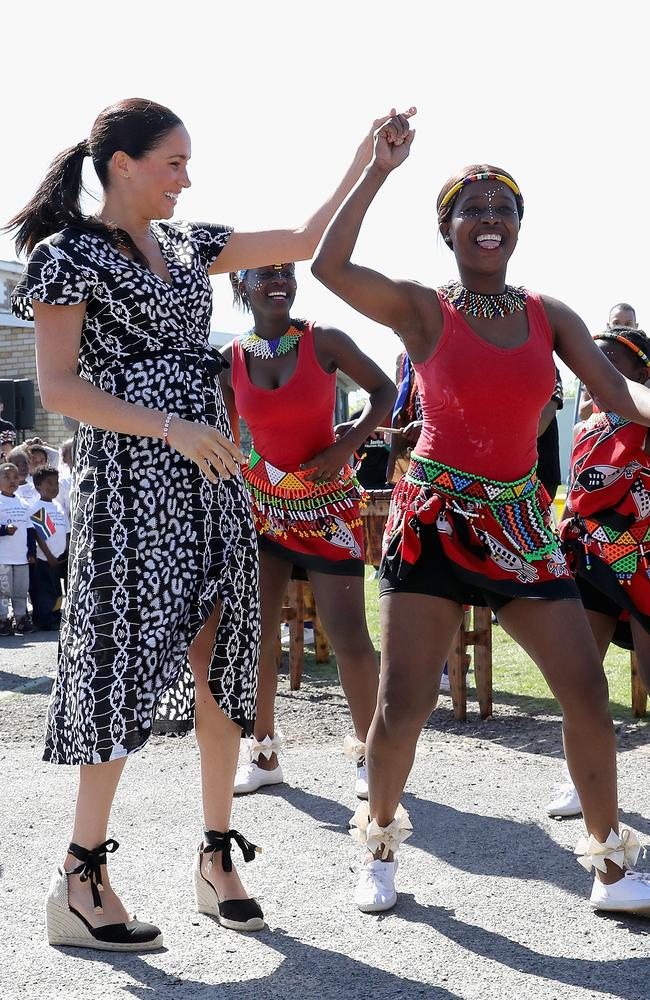 Meghan gets into the groove during the fun visit. Picture: Chris Jackson/Getty Images