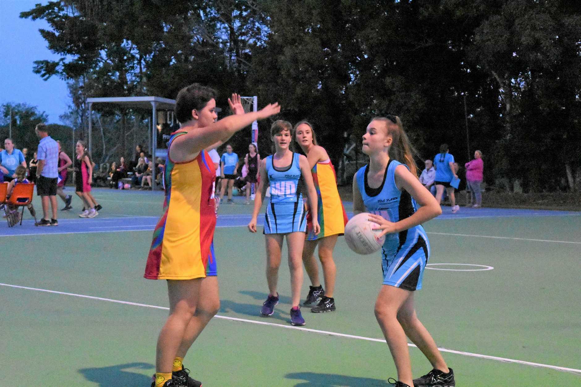 Jaydee Marschke tries to pass through defender Jodie Hall.