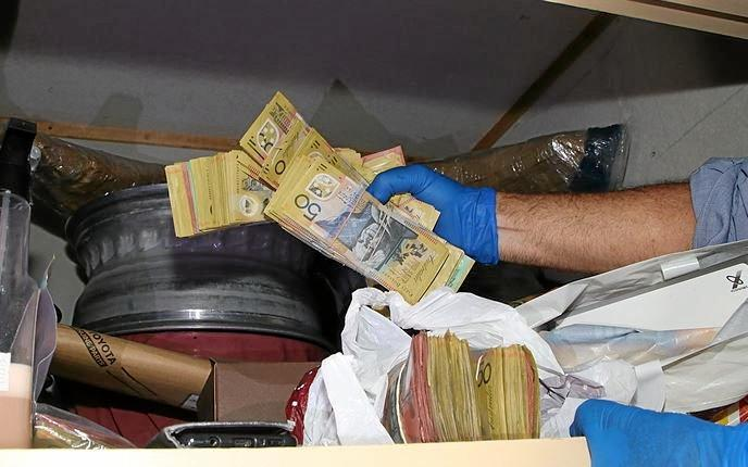 Maryborough detectives seized over $122,000 in cash.