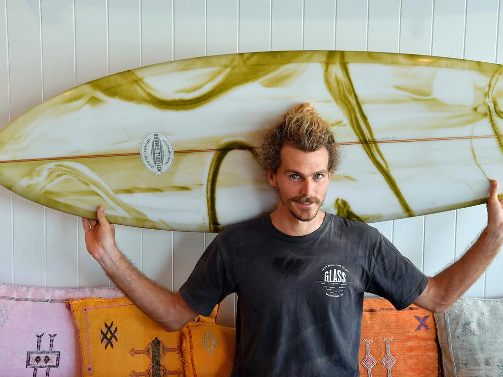 Mitchell Surman with the surfboard he designed for Tegen White who has terminal cancer. Photo: John McCutcheon / Sunshine Coast Daily