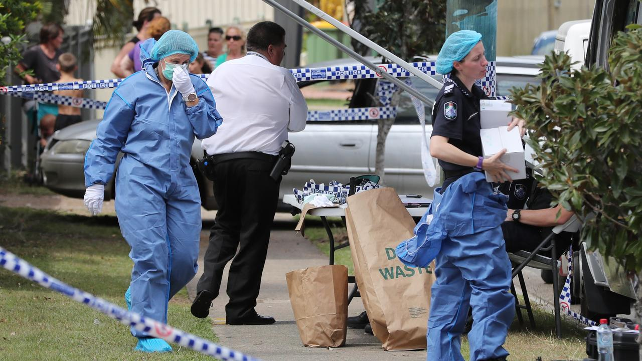 Forensic officers at the home at Crestmead yesterday