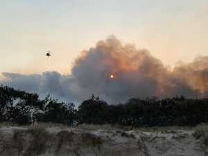 Noosa North Shore camping spots reopen after fire