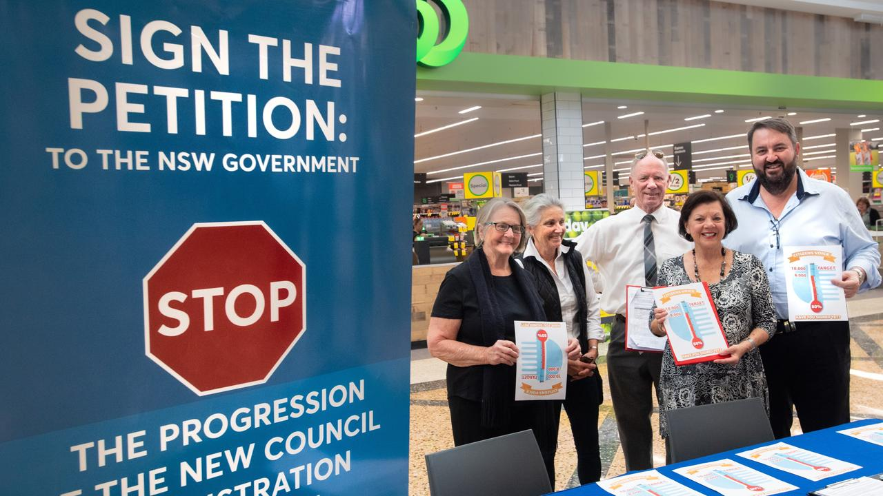Marian Partos, Ann Leonard, Andrew Fraser, Fran Stevenson and Steve Gooley with the petition to halt the Cultural and Civic Space.