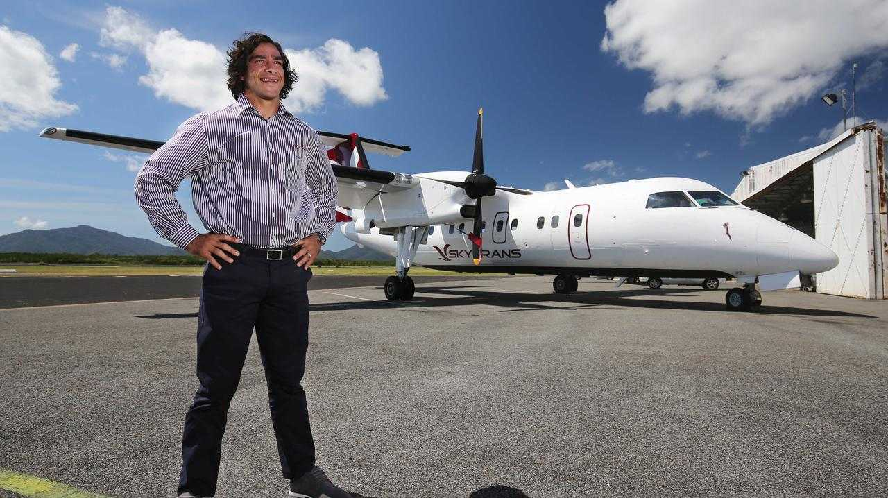 Skytrans co-owner and North Queensland Cowboys halfback Johnathan Thurston in front of one of his company's aircraft at Cairns Airport. PICTURE: BRENDAN RADKE