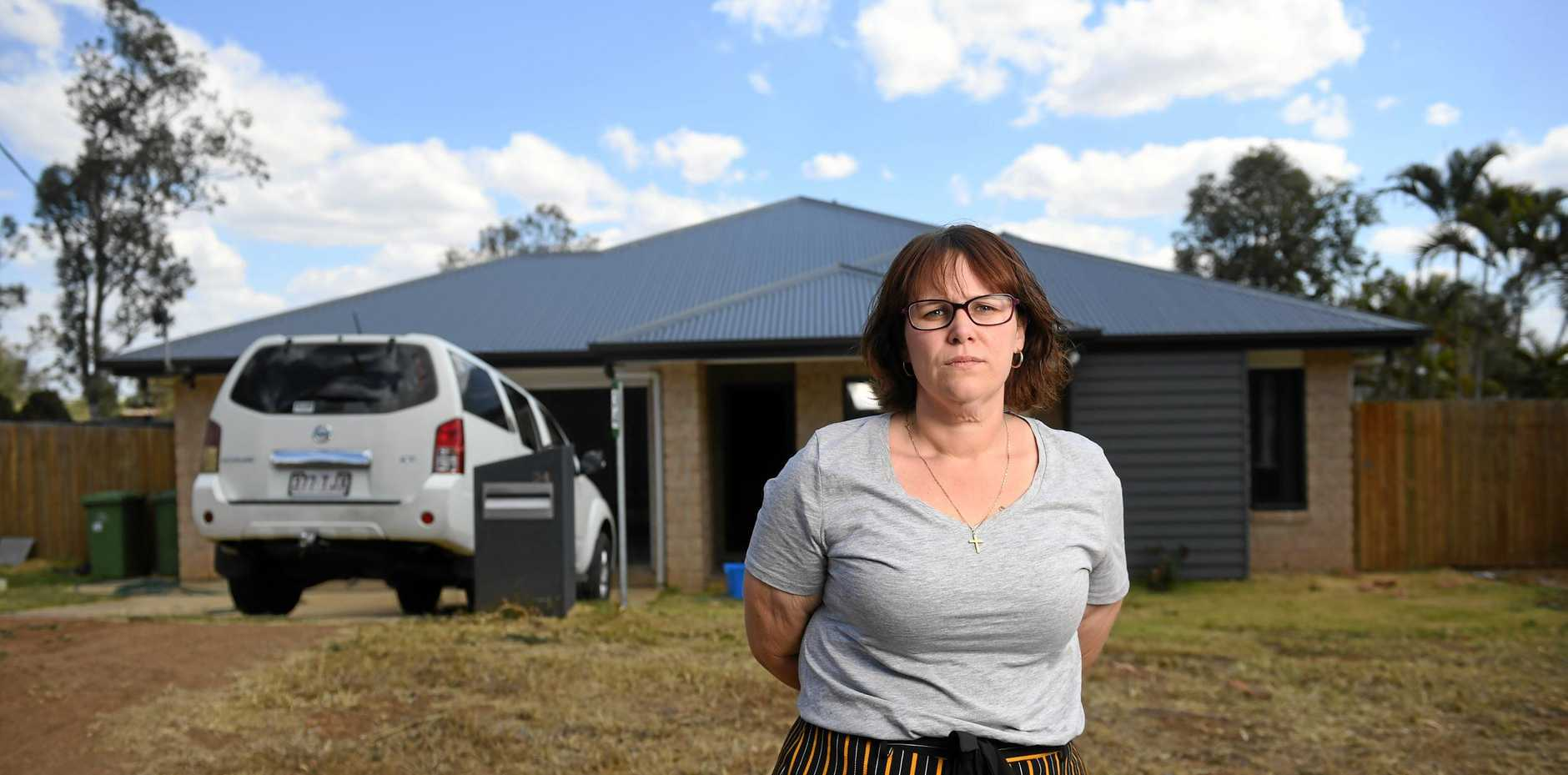FED UP: Rachel Thorley and her partner moved into their newly built home at Fernvale a year ago. They have been left frustrated with a number of defects to the house and struggled to get help after G.J Gardner's North Ipswich franchise went bust in January.