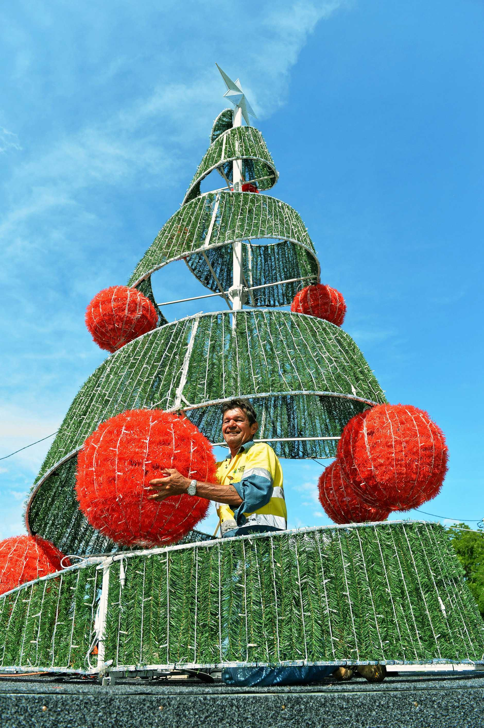 Leading Hand Tony Chapman from Gympie Regional Council putting the finishing touches to this year's brand new christmas tree. Photo: Greg Miller / Gympie Times