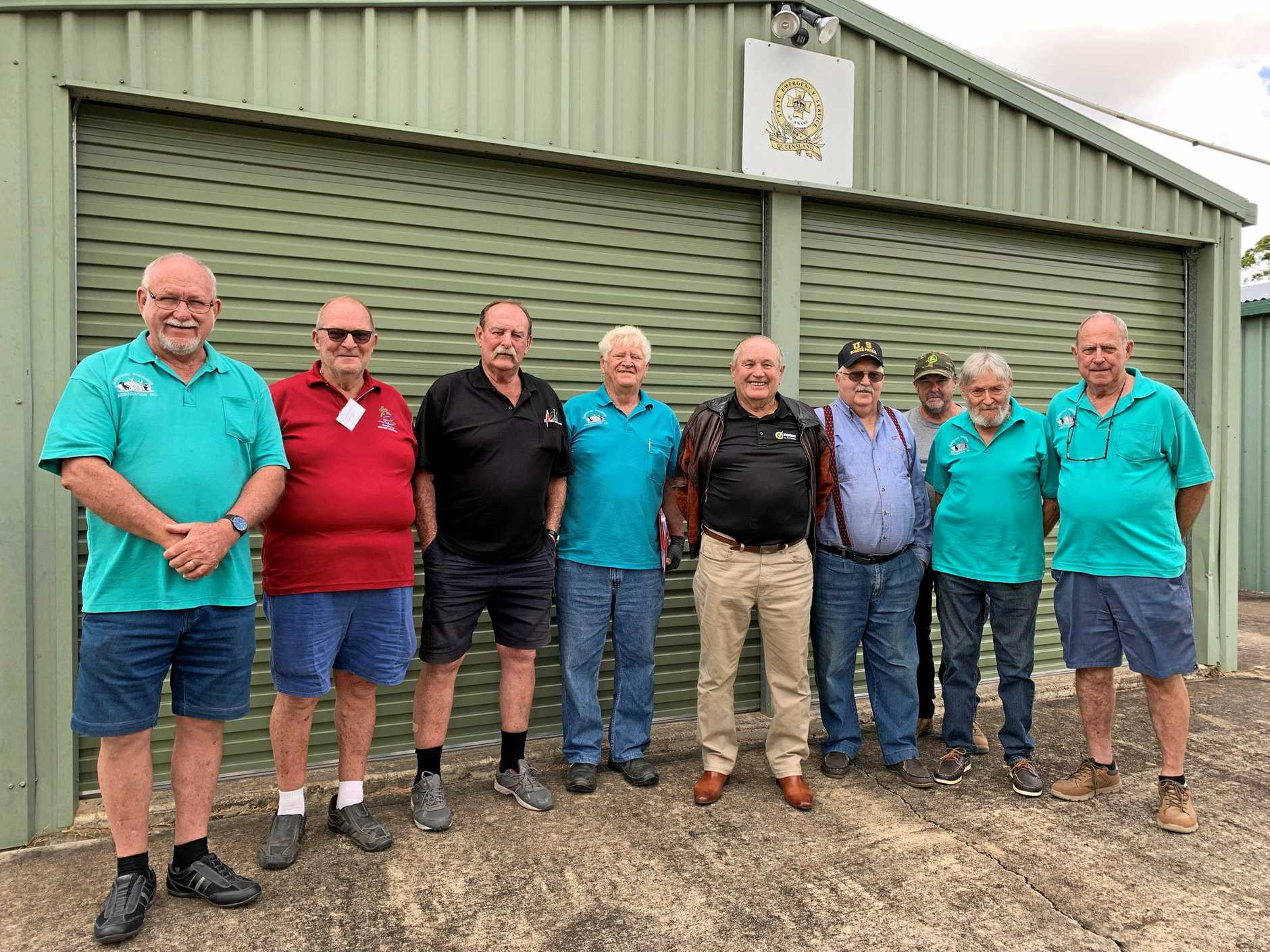 BUILDING SUPPORT: Glenwood Men's Shed chairman David Legge (second from left) says the group is making a big difference to lives in his community.