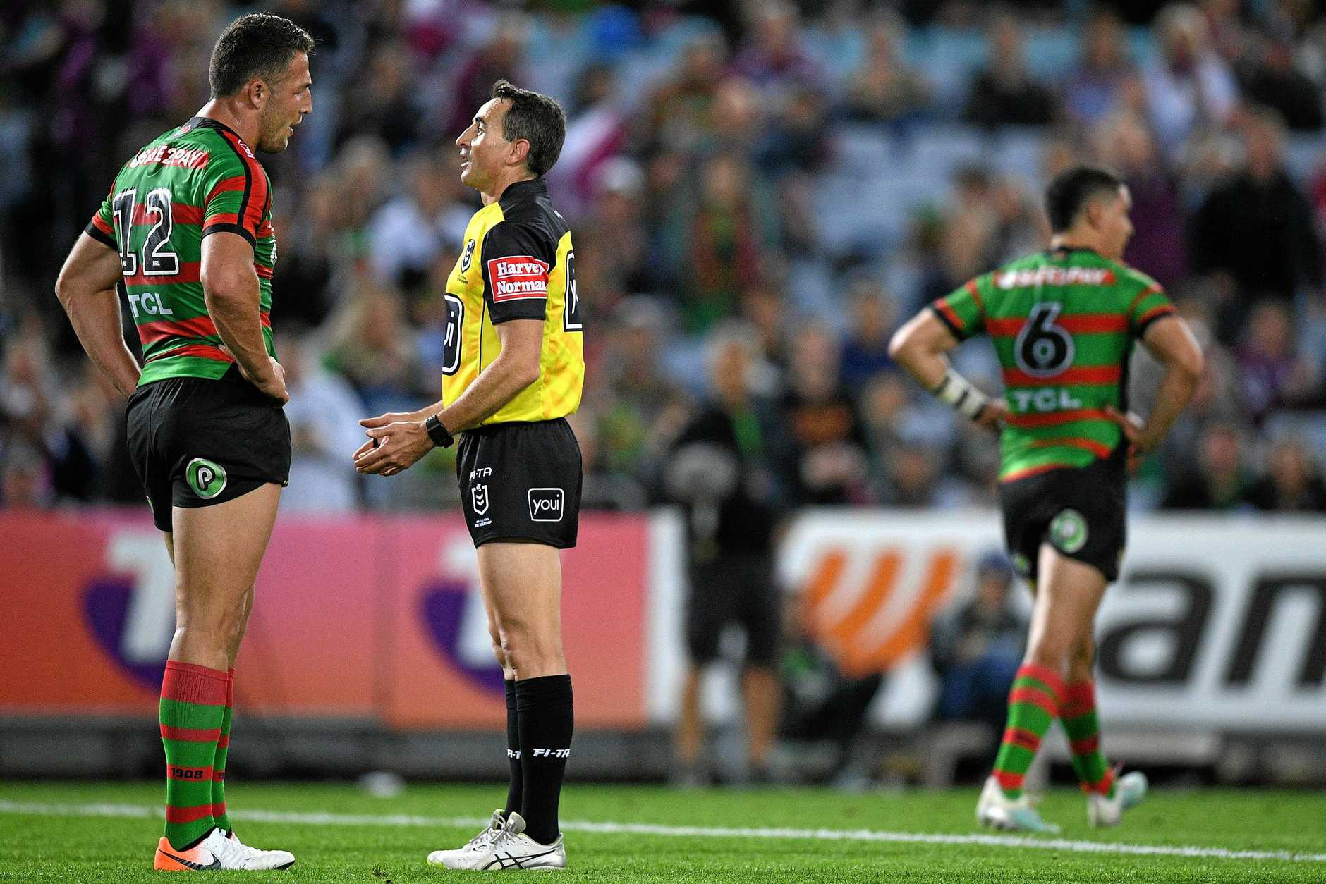 Sam Burgess remonstrates with referee Gerard Sutton after Cody Walker was sent to the bin.