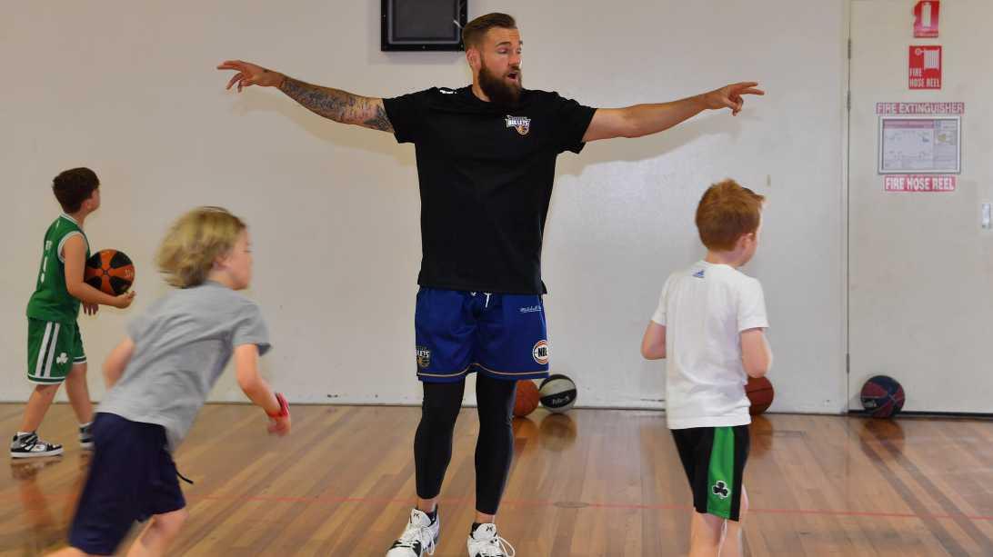 Brisbane Bullets basketball player Jeremy Kendle hosting a camp for children at University of the Sunshine Coast. Photo: John McCutcheon / Sunshine Coast Daily
