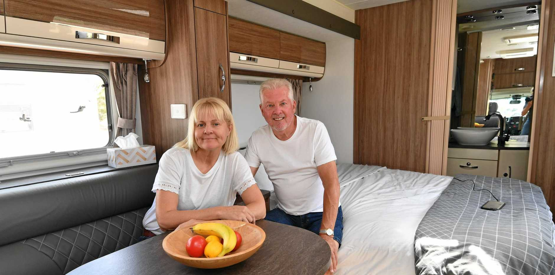 REPEAT VISIT: Norm Brereton and Bronnie Moore in their motorhome at the Alan and June Brown carpark in Maryborough.