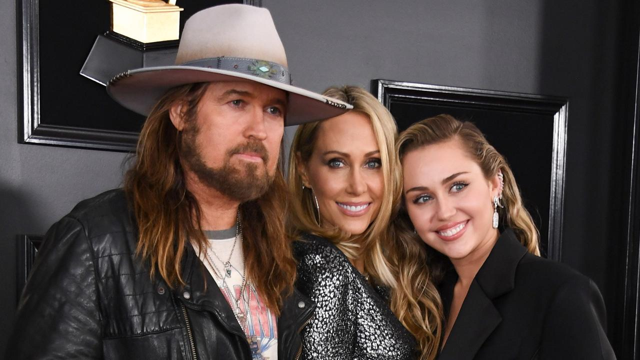 Miley Cyrus poses with her parents Billy Ray Cyrus and Tish Cyrus at the 61st Annual Grammy Awards. Picture: Valerie Macon / AFP