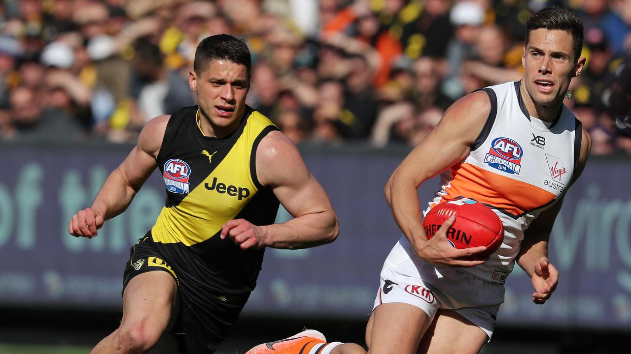 Josh Kelly with the ball and Dion Prestia in hot pursuit. Picture: Michael Klein.