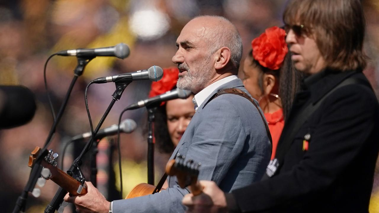 Artist Paul Kelly performs during the 2019 AFL Grand Final between the Richmond Tigers and the GWS Giants at the MCG in Melbourne, Saturday, September 28, 2019. Picture: Michael Dodge/AAP.