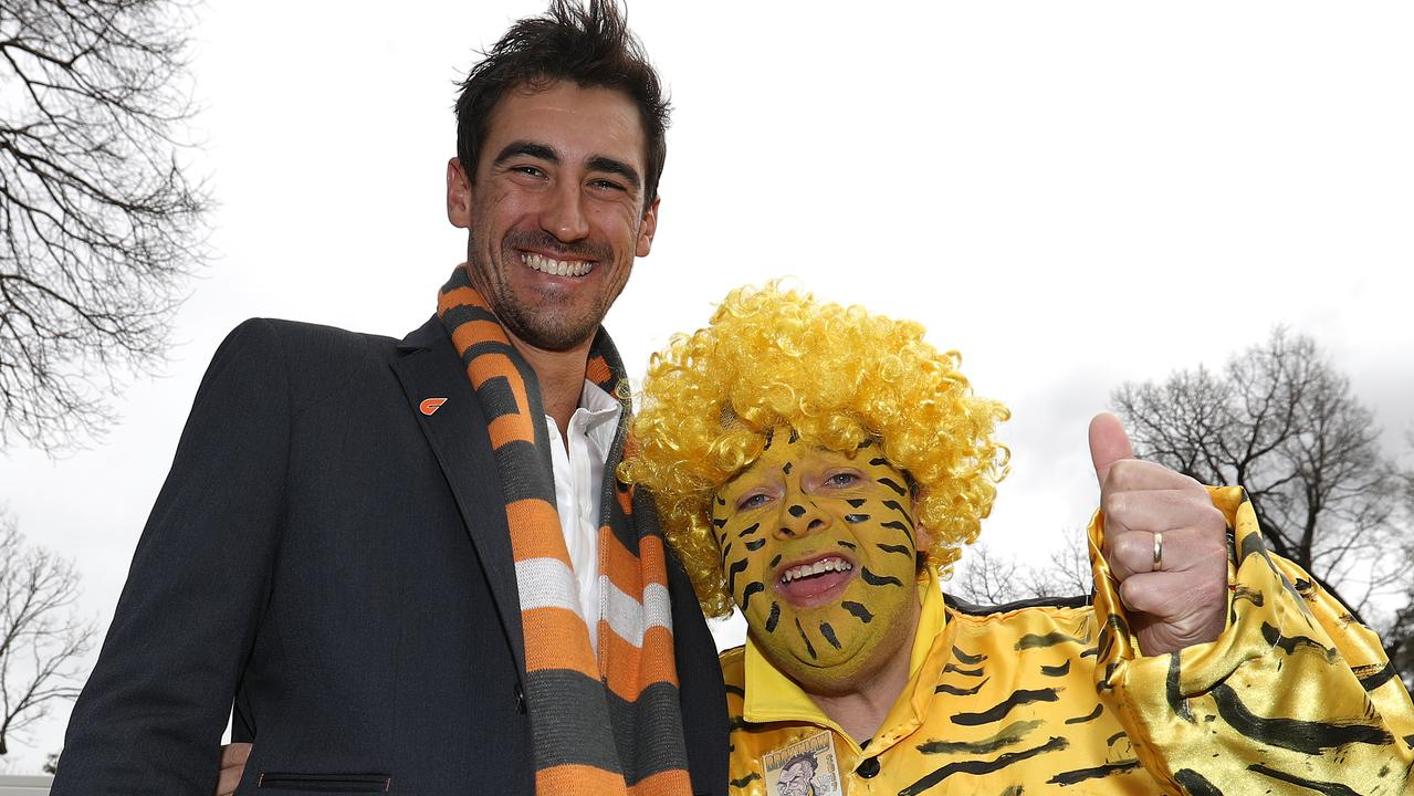 Australian cricketer and Giants fan Mitchell Starc poses with a fan ahead of the 2019 AFL Grand Final. Picture: Robert Cianflone, AFL Photos via Getty Images.