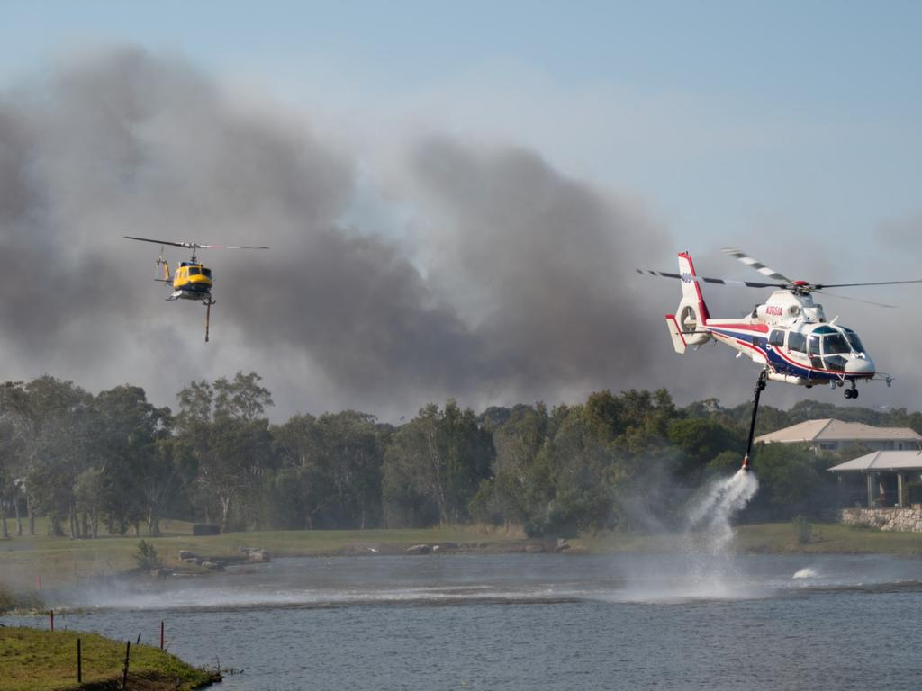 Helicopters taking on water to water-bomb the fire. The water-bombing at the Weyba Downs area, adjacent to Peregian Springs, Peregian Spring Golf Course - (taken 10/9/2019) - Photo Ian Martin