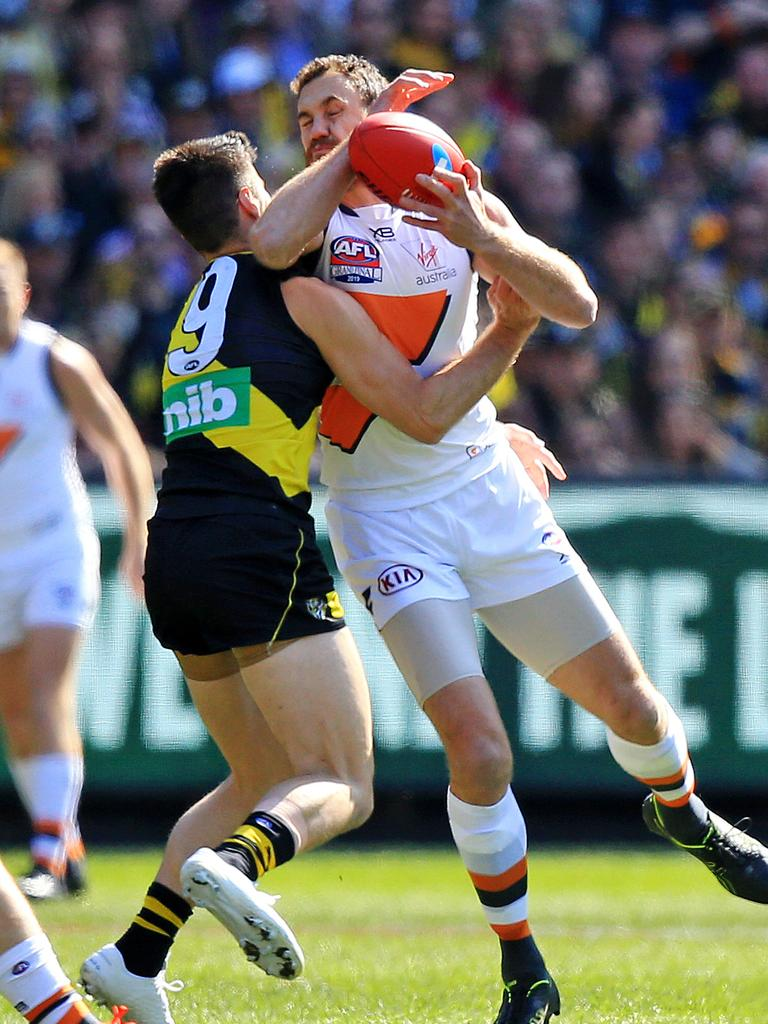 Trent Cotchin of the Tigers contests with Shane Mumford of the Giants during the 2019 AFL Grand Final match between the Richmond Tigers and the GWS Giants at the MCG on September 28, 2019 in Melbourne, Australia. Picture: Mark Stewart
