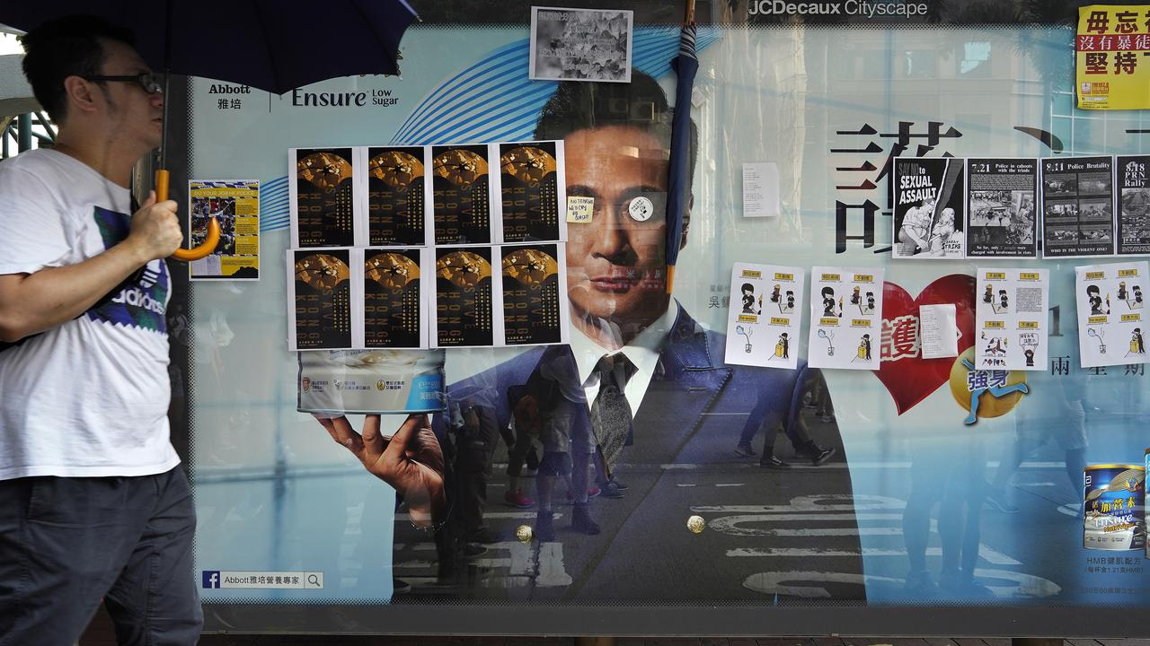 Bus stop advertisement filled with protest art posters. Picture: AP Photo/Vincent Yu.