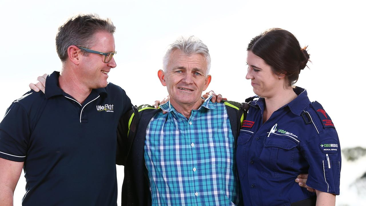 Paul Reball (in the middle) with Dr Jeff Hooper and paramedic Madison Leighton-Jones, who saved his life when he had a heart attack at the Bridge to Brisbane. Picture: Adam Head
