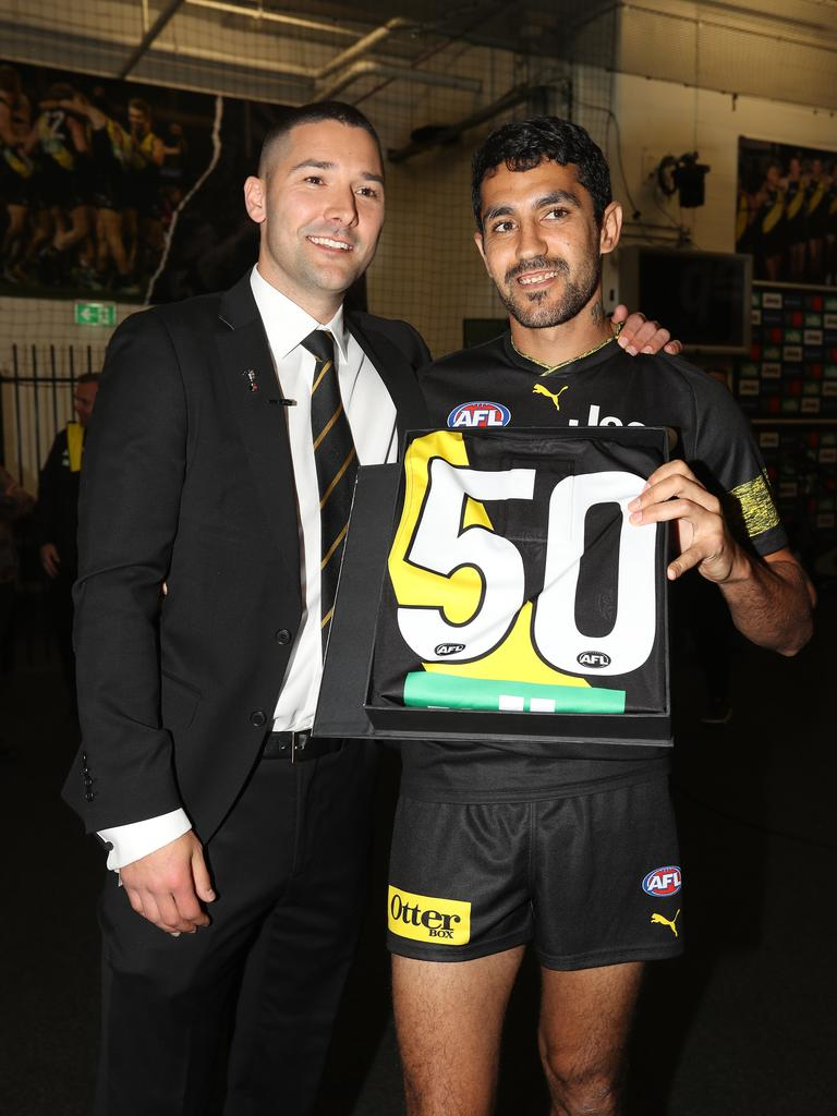 Marlion Pickett of the Tigers is presented with his jumper by Shaun Grigg. (Photo by Robert Cianflone/AFL Photos/via Getty Images )