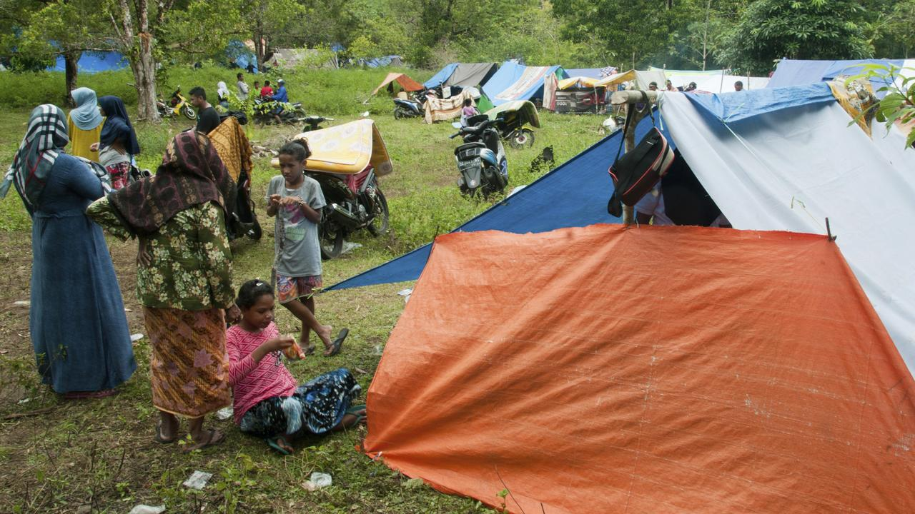 Earthquake survivors stand near their tents at a temporary shelter in Ambon. Picture: Tiara Salampessy/AP