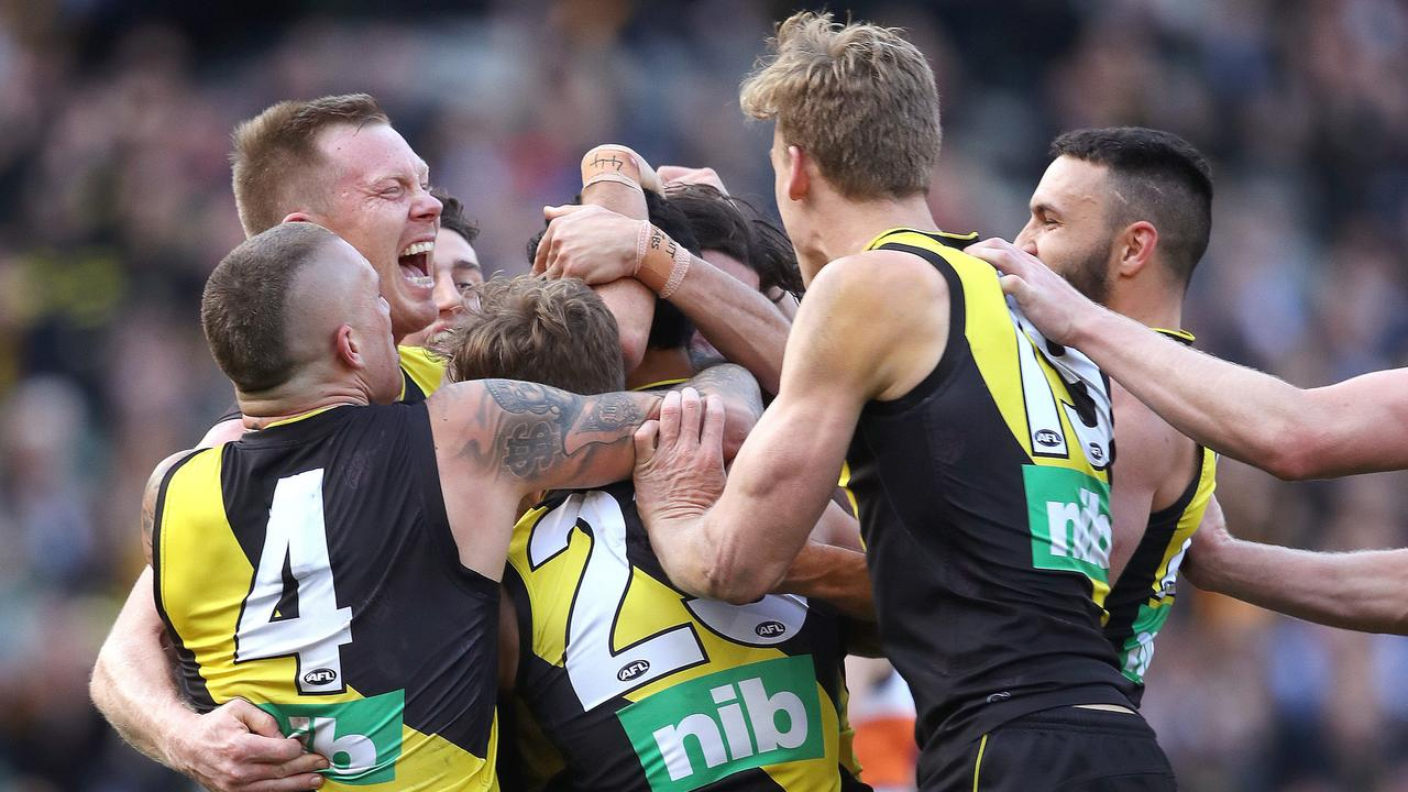 Marlion Pickett is mobbed by Richmond teammates after kicking his first AFL goal. Picture: Phil Hillyard