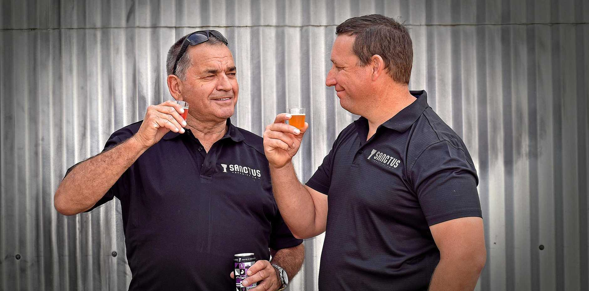 Steve Newton and Banjo Hillier from Sanctus Brewing Company enjoy a taste of their latest brew while at the 2019 Gate to Plate in Grafton on Sunday.