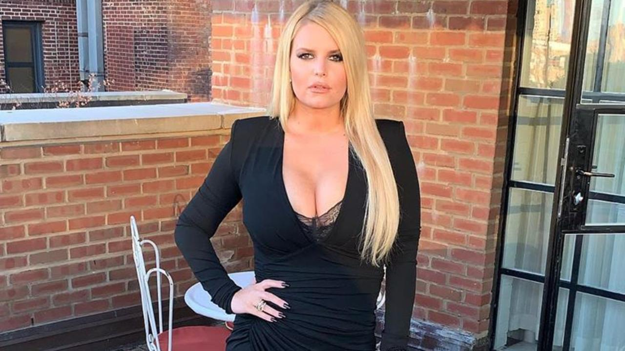 Jessica Simpson shows off the results of six months of hard work.