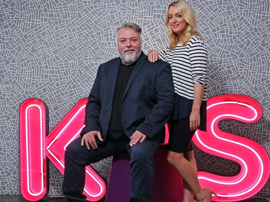 Kyle Sandilands, pictured with KIIS co-host Jackie Henderson, remains holed up in his Los Angeles mansion/