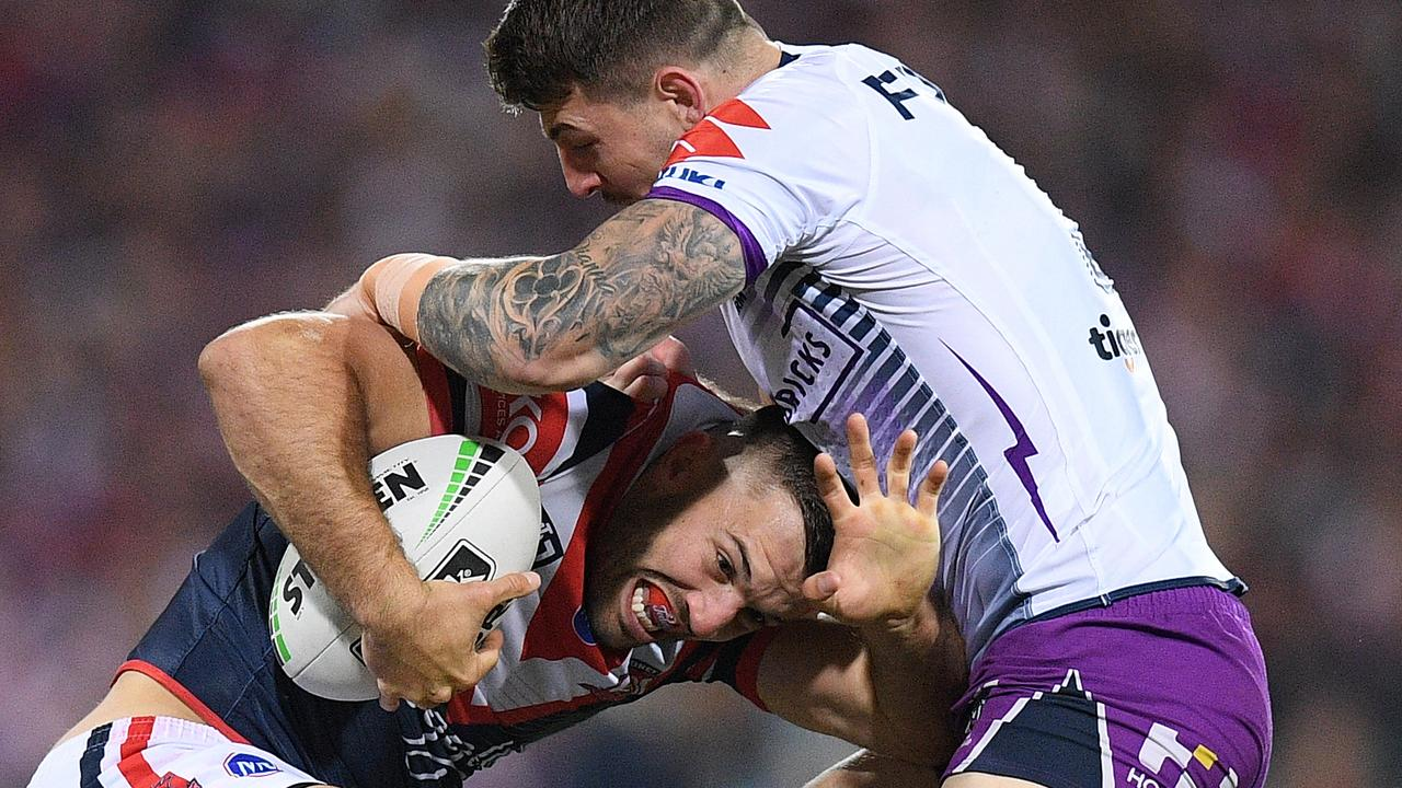 James Tedesco runs into Storm star Curtis Scott on Saturday night.