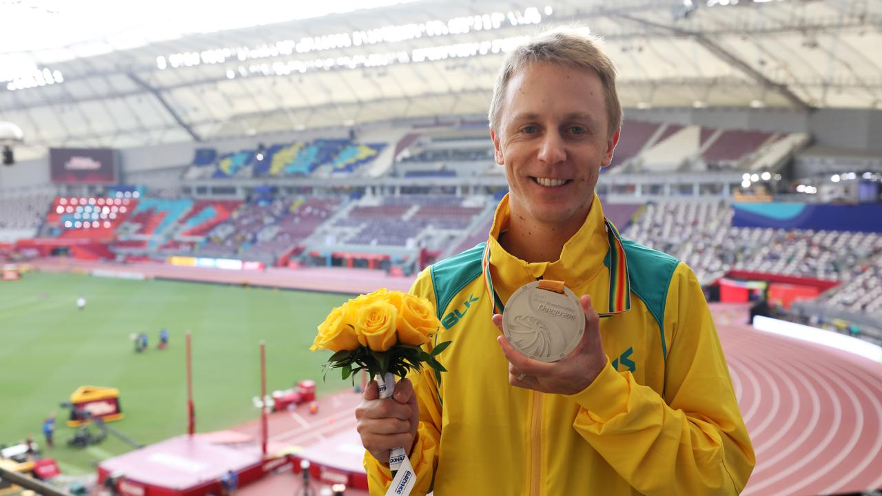 Jared Tallent poses with an upgraded silver medal. Picture: Christian Petersen/Getty Images
