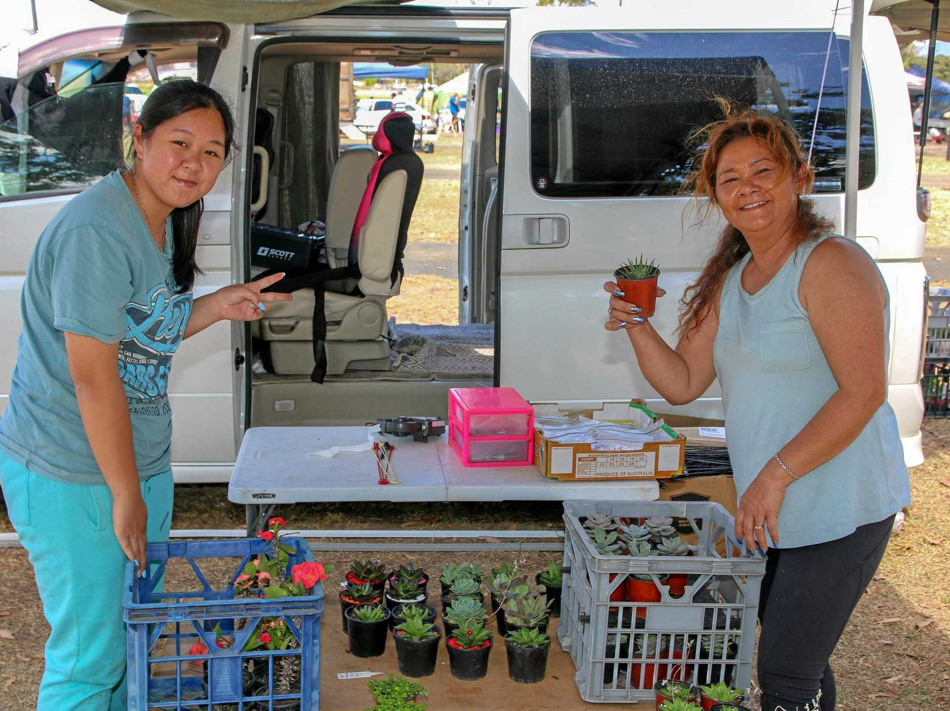 TOP SHOP: Tulang Truong and Narin Shamoun at the Laidley Country Markets this morning. Local and visitors a like to the opportunity to snap up some deals and enjoy the warm weather.