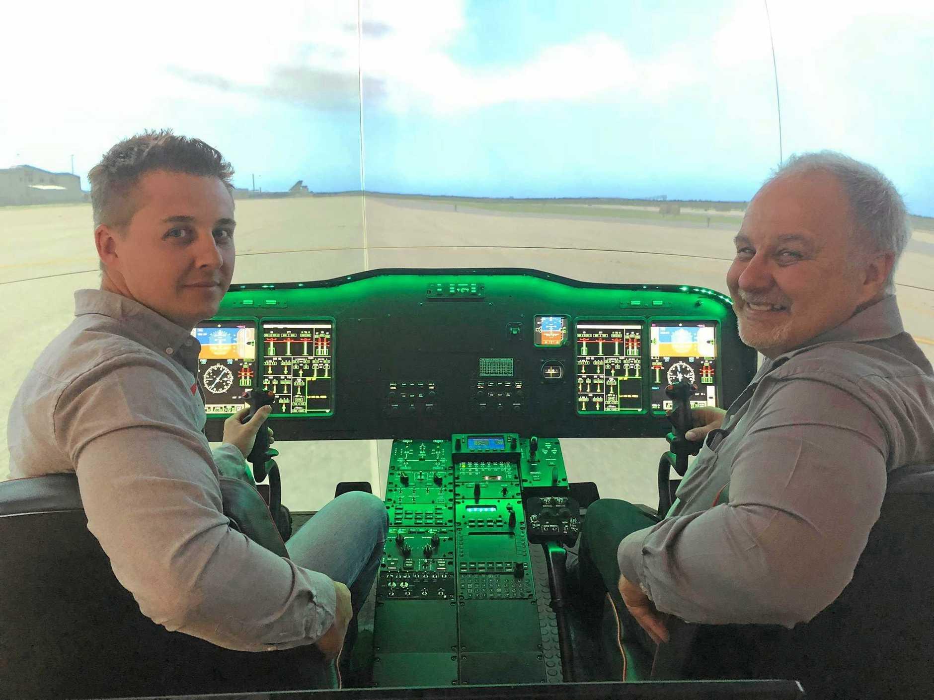 Chris and Charles du Plessis of Geosim Technologies inside its AW139 simulator.