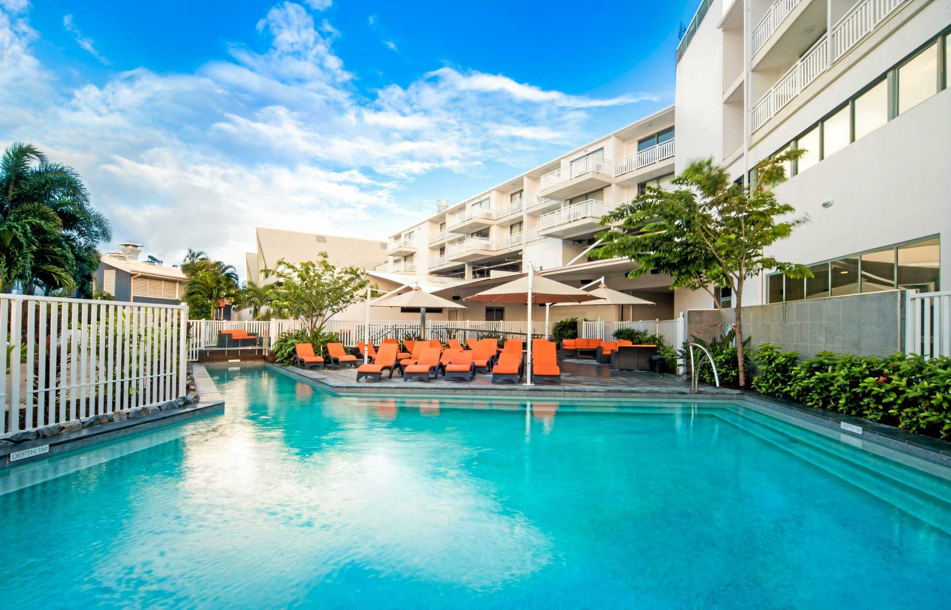 The iconic Airlie Beach Hotel freehold and leasehold rights have been bought by a Queensland hotel group for a combined $22 million.