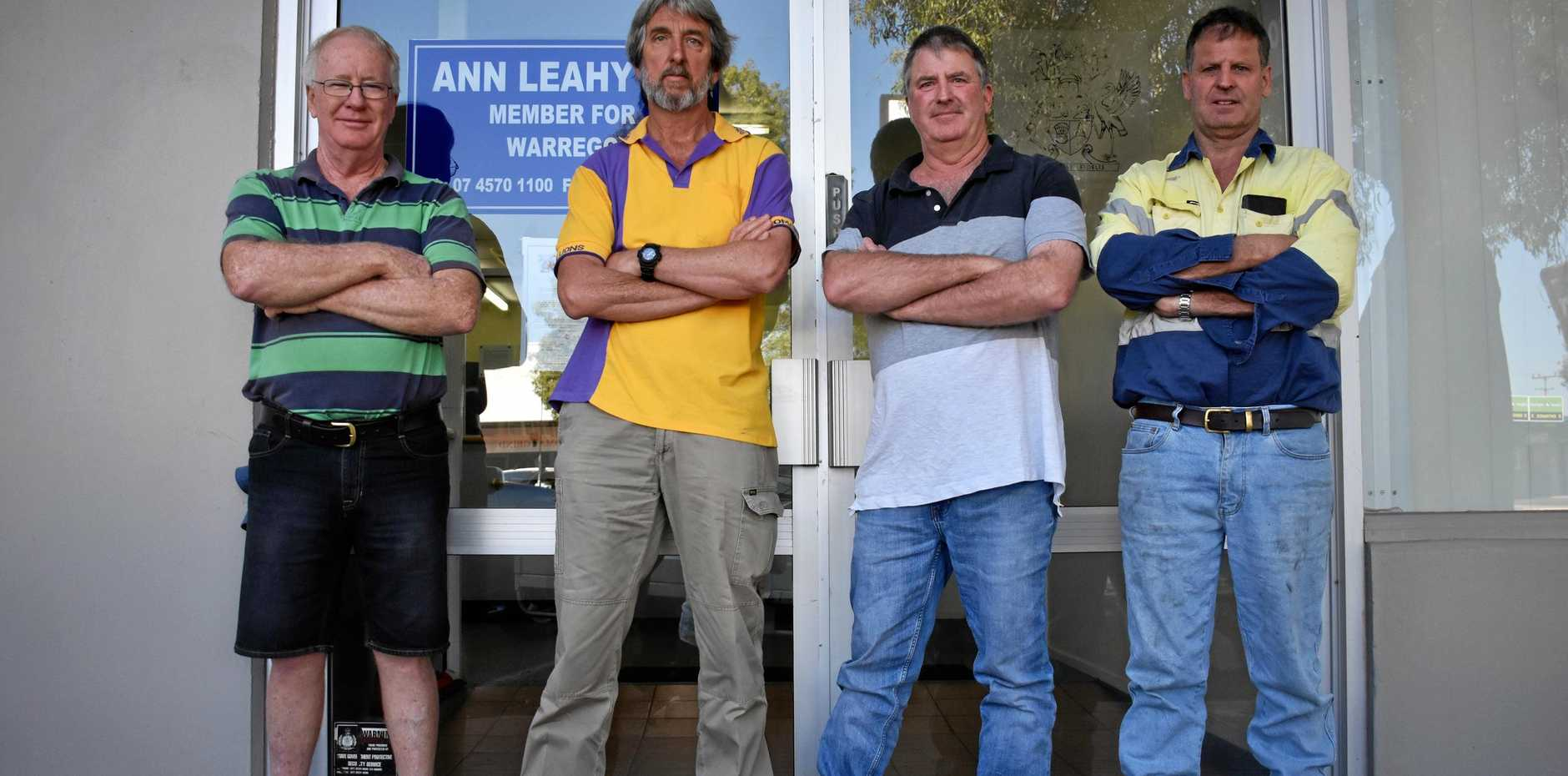 TAKING A STAND: Gary Law, Rick Grinsell, Grant Baker and Dale Baker protested outside Ann Leahy's office Friday morning over vandalism.