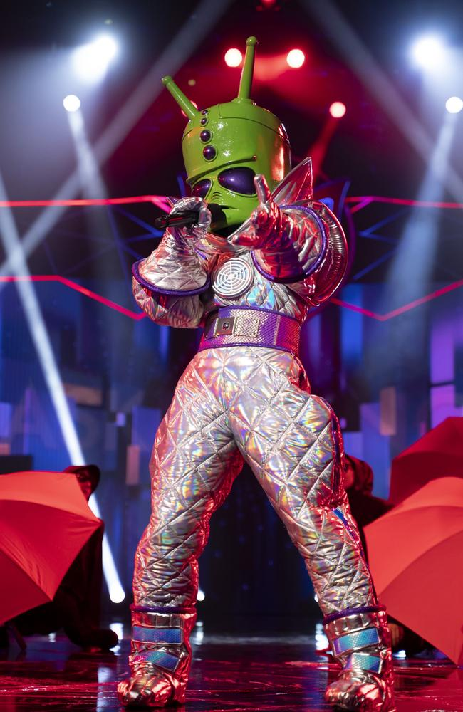 Strawberry Kisses And Farewell Hugs — Nikki Webster revealed a the alien on The Masked Singer Australia. Picture: 10