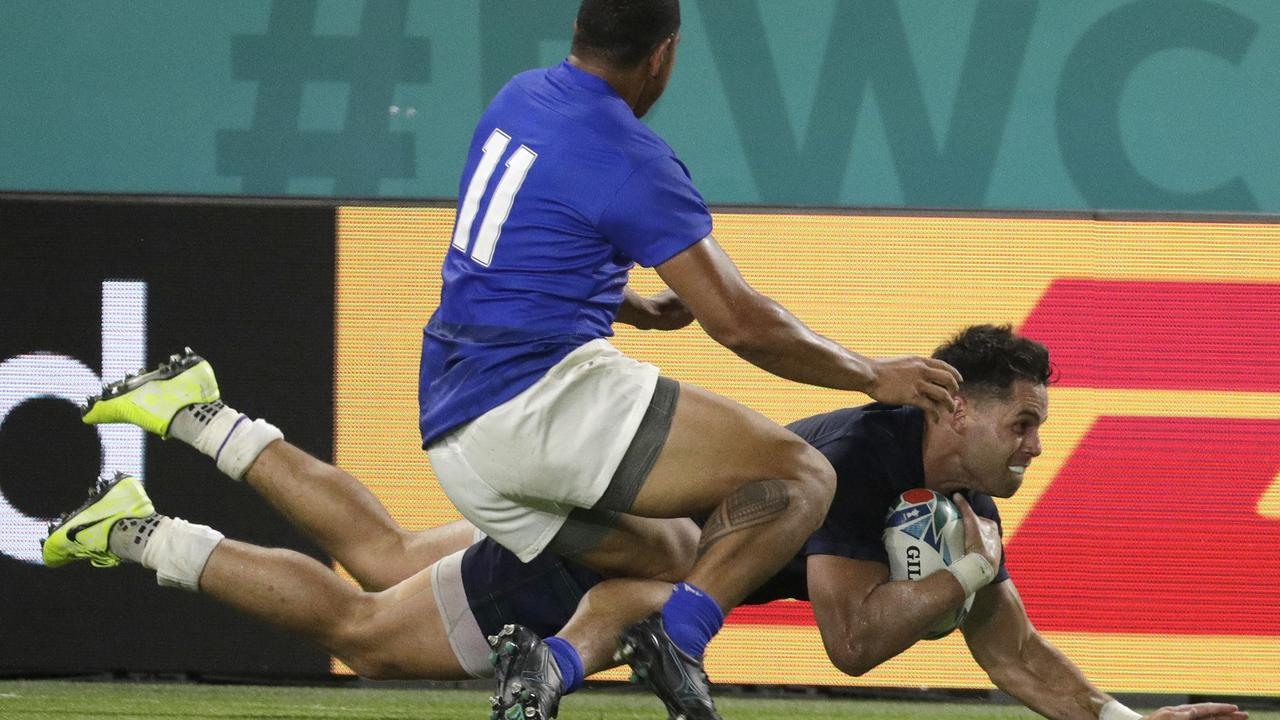 Samoa's Ed Fidow slides his knees into Sean Maitland late in the contest against Scotland.