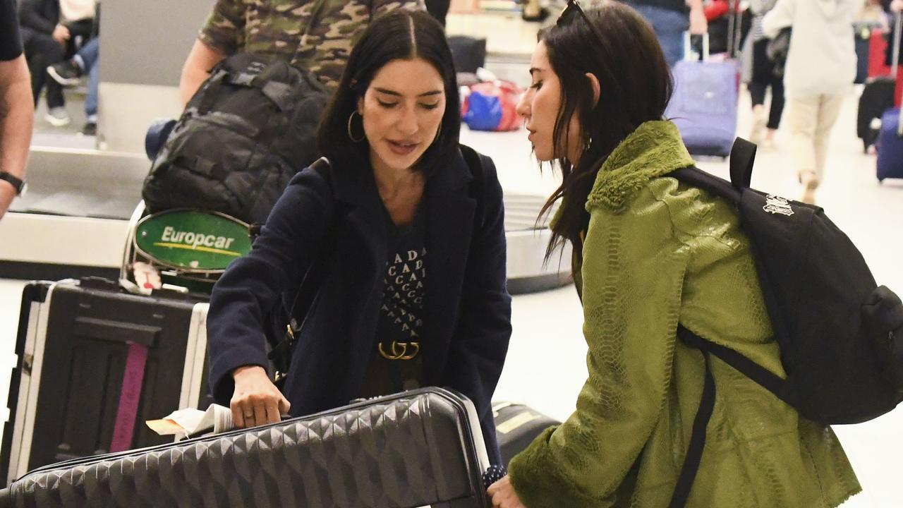 The sisters reached for their own luggage on the carousel belt at Sydney Airport. Picture: Media-mode.com