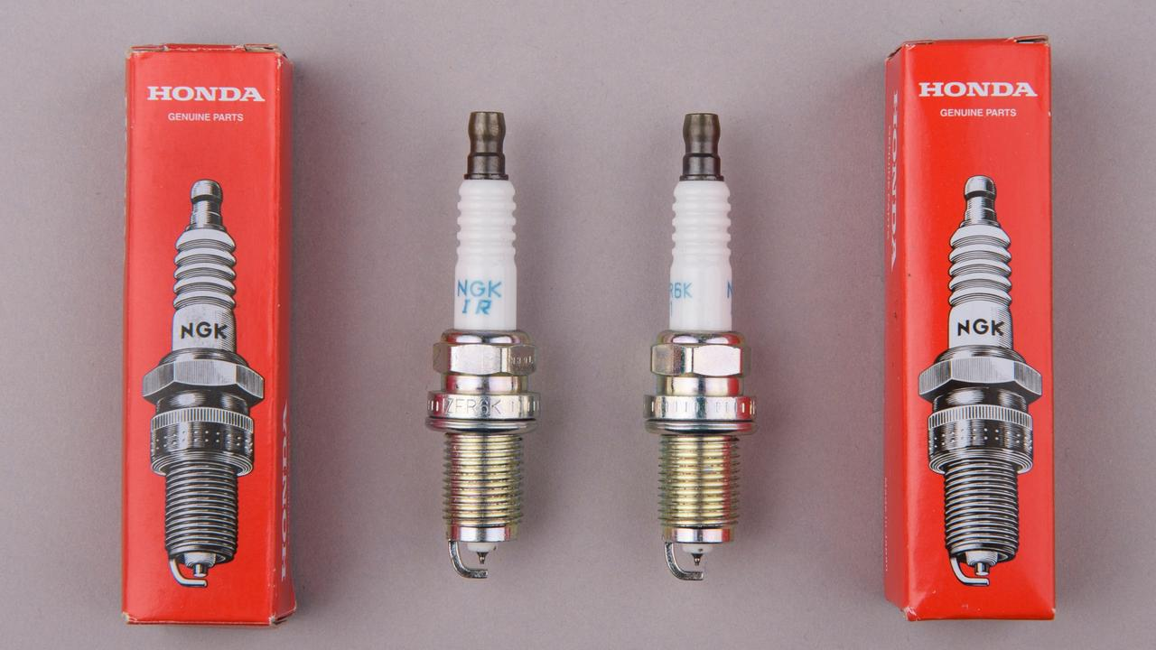 Counterfeit spark plugs (right) can be indistinguishable from genuine items (left).
