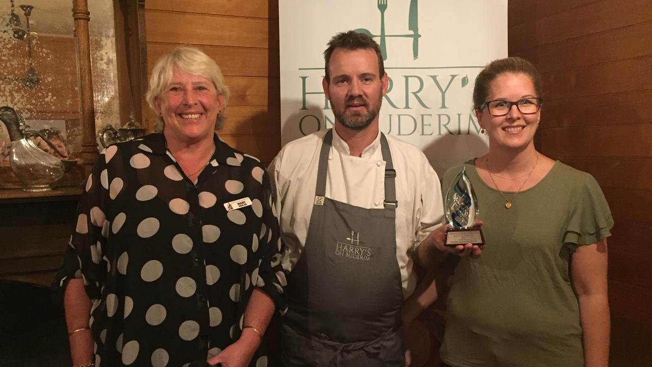 Sunshine Coast Gourmet Club president Mary Nolan presents the Restaurant of the Year award to Stuart and Lisa Bell at Harry's on Buderim.
