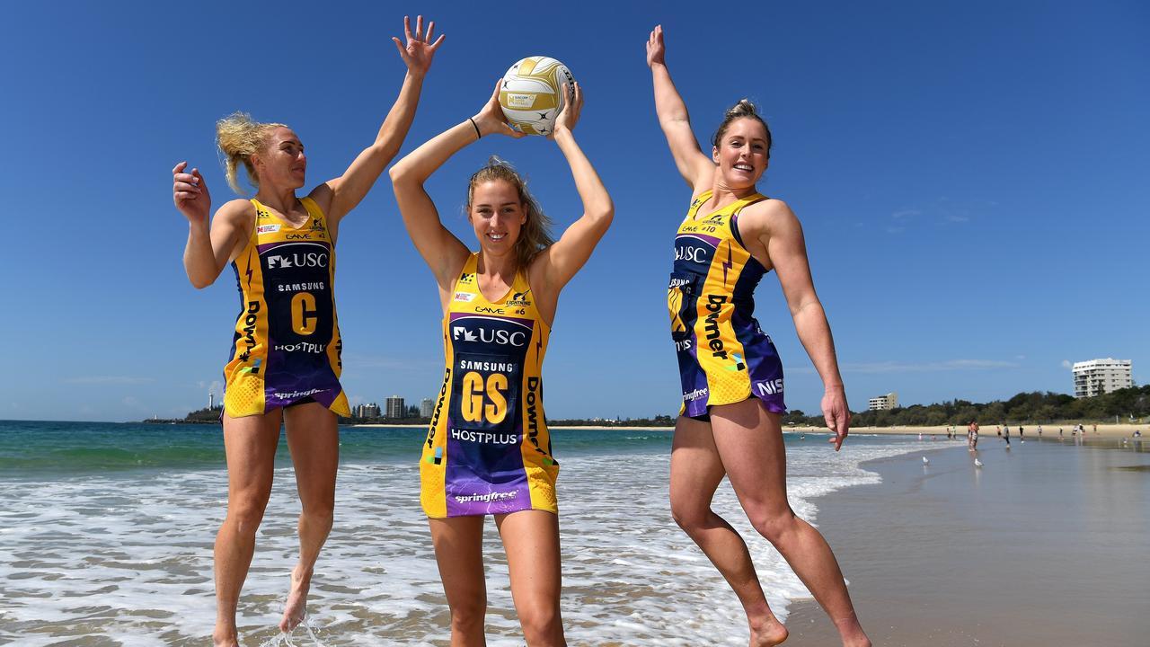 Sunshine Coast Lightning players Laura Langman, Cara Koenen and Laura Scherian on Mooloolaba Beach.