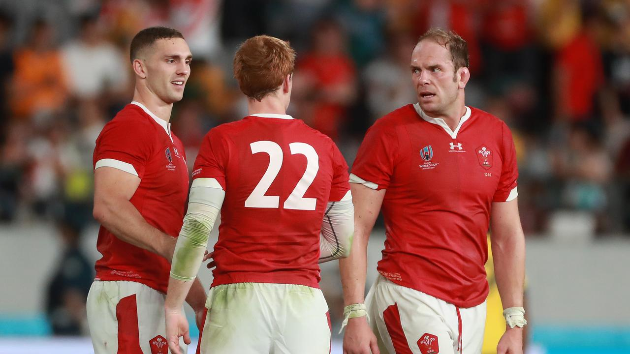 Rhys Patchell is congratulated by teammates Alun Wyn Jones (right) and George North (left) after Wales' victory. (Photo by David Rogers/Getty Images)