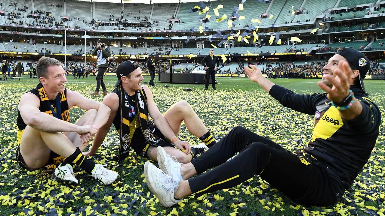 The formidable trio making confetti snow angles — Dylan Grimes, David Astbury and Alex Rance. Picture: Quinn Rooney