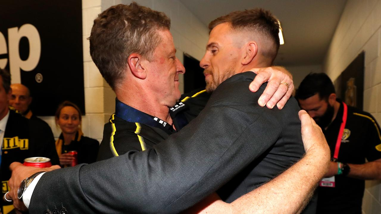 Always a Tiger great — injured Giant cuddles former coach Damien Hardwick. Picture: Michael Willson