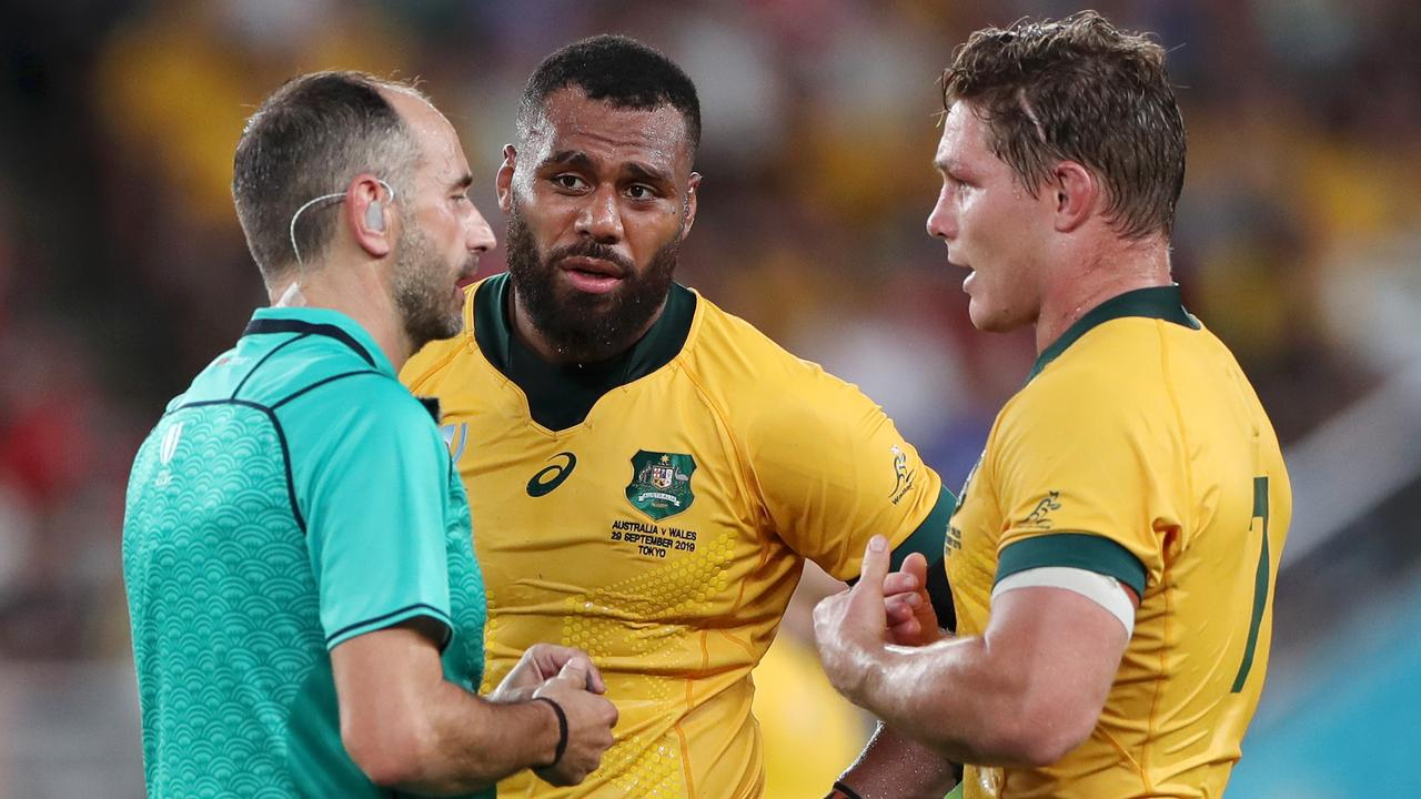 Referee Romain Poite spoke with Samu Kerevi after an infringement against Wales. Picture: Dan Mullan
