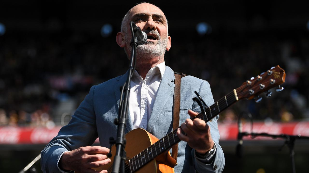 Paul Kelly sings during the 2019 AFL Grand Final at the Melbourne Cricket Ground. Picture: Daniel Carson/AFL Photos via Getty Images