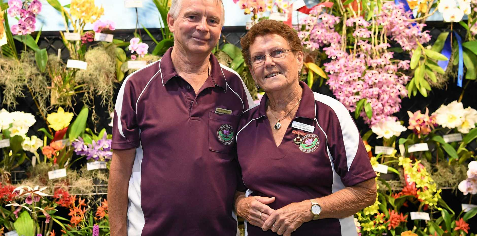 FUN AND FLOWERS: Darryl Coombes and Daphne McKenna from the Hervey Bay Orchid Society at the event on the weekend.